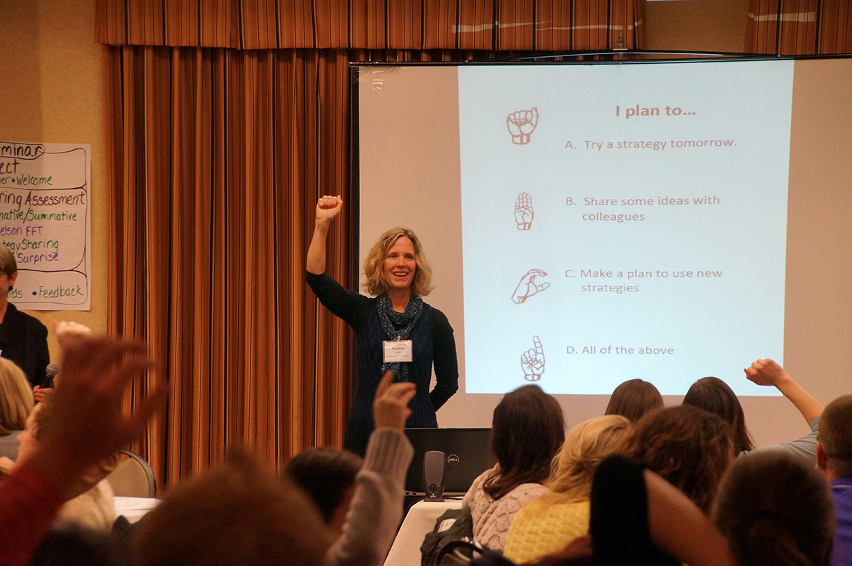 Heather Lott, seminar facilitator and New Educator Coordinator for Madison Metropolitan School District, demonstrates how ABCD sign language is another quick way to scan your students for comprehension, or an opinion, or intention.