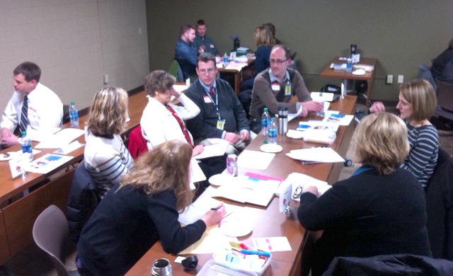 Districts with similar mentor models form groups to talk about ideas they've just heard at the December 8, 2014 District Council meeting.